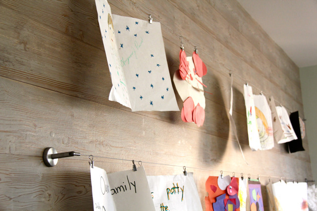 Curtain wire and clips are perfect for displaying kids' art because you can interchange the artwork!Get the instructions here