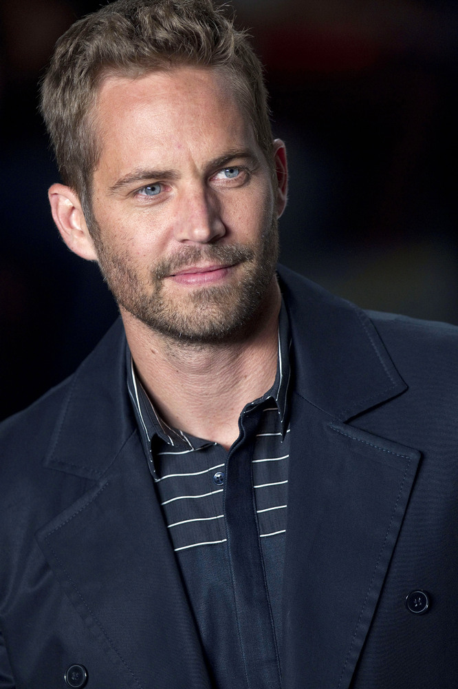 File-This March 21, 2013 file photo shows actor Paul Walker wearing a creation from the Colcci summer collection at Sao Paulo