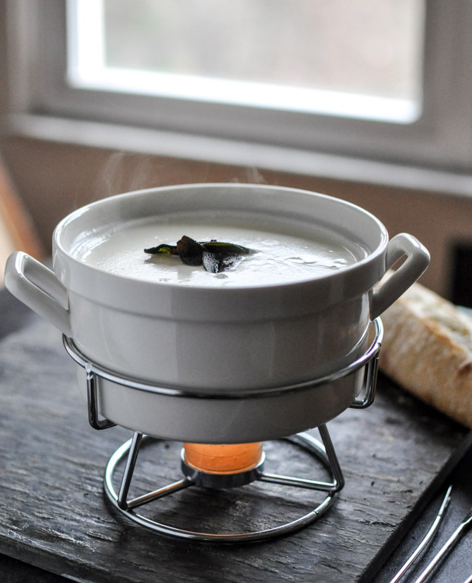 """<strong>Get the <a href=""""http://www.howsweeteats.com/2012/12/goat-cheese-fondue-with-fried-sage/"""" target=""""_blank"""">Goat Cheese"""