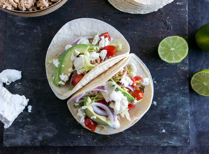 """<strong>Get the <a href=""""http://www.howsweeteats.com/2013/03/smokey-roasted-chicken-tacos-with-spicy-goat-cheese-queso/"""">Smok"""