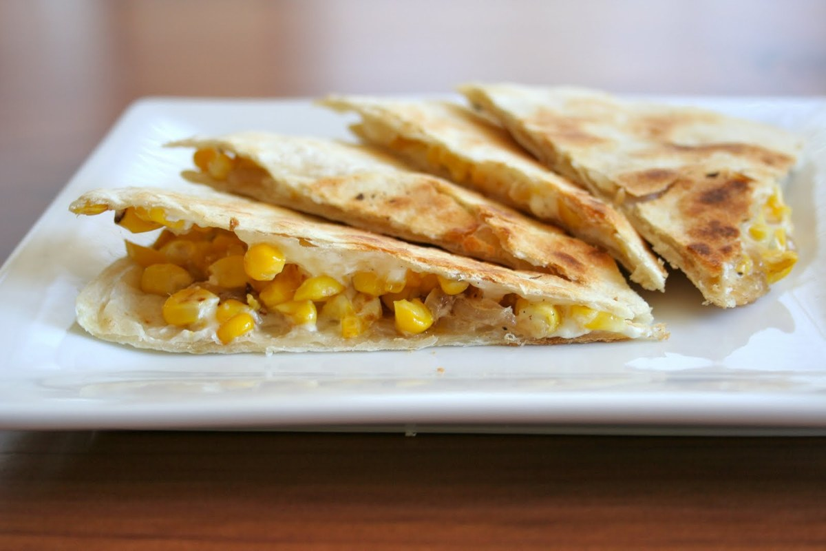 """<strong>Get the <a href=""""http://food52.com/recipes/13747-roast-corn-goat-cheese-and-caramelized-onion-quesadilla"""">Roast Corn,"""