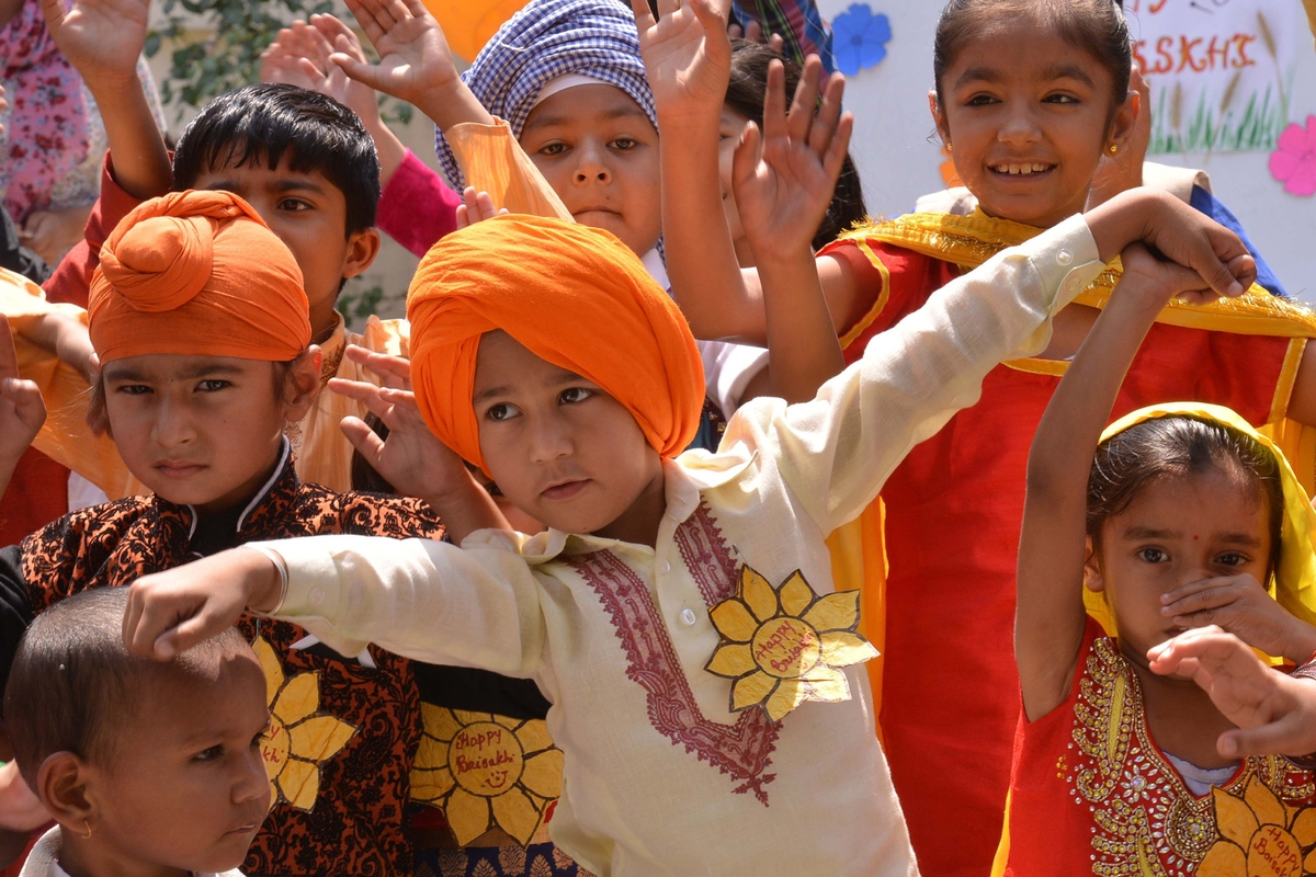 Indian school children perform during a celebration of the Baisakhi festival at a school in Amritsar on April 13, 2015.