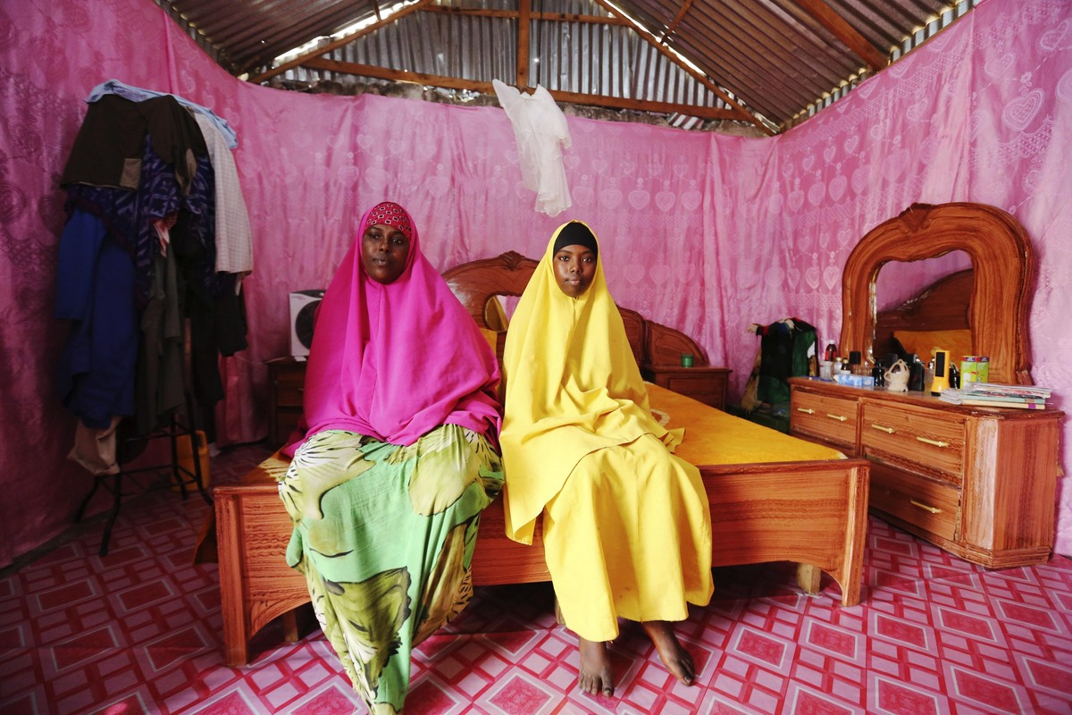 Saciido Sheik Yacquub, 34, poses for a picture with her daughter Faadumo Subeer Mohamed, 13, at their home in Hodan district