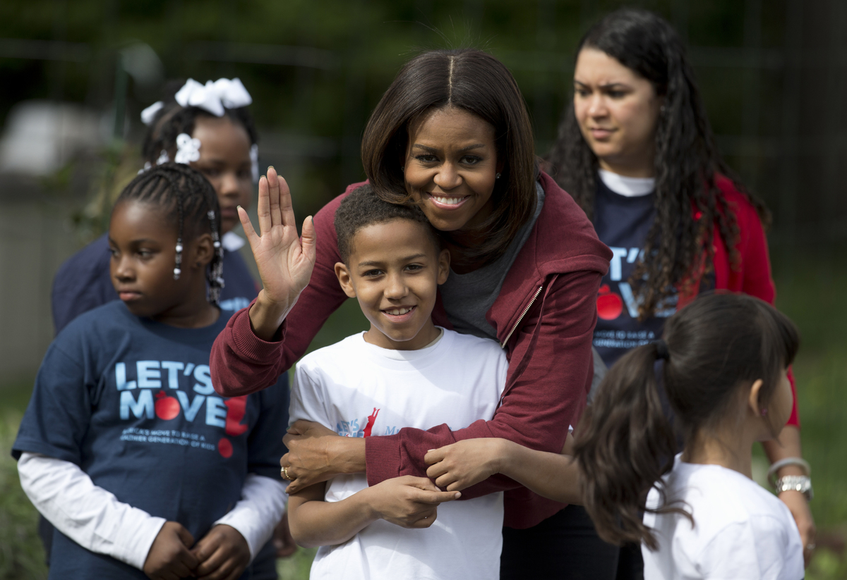 First lady Michelle Obama poses for a photo with Nare Kande, 9, a student from the New York Botanical Gardens in the Bronx, N