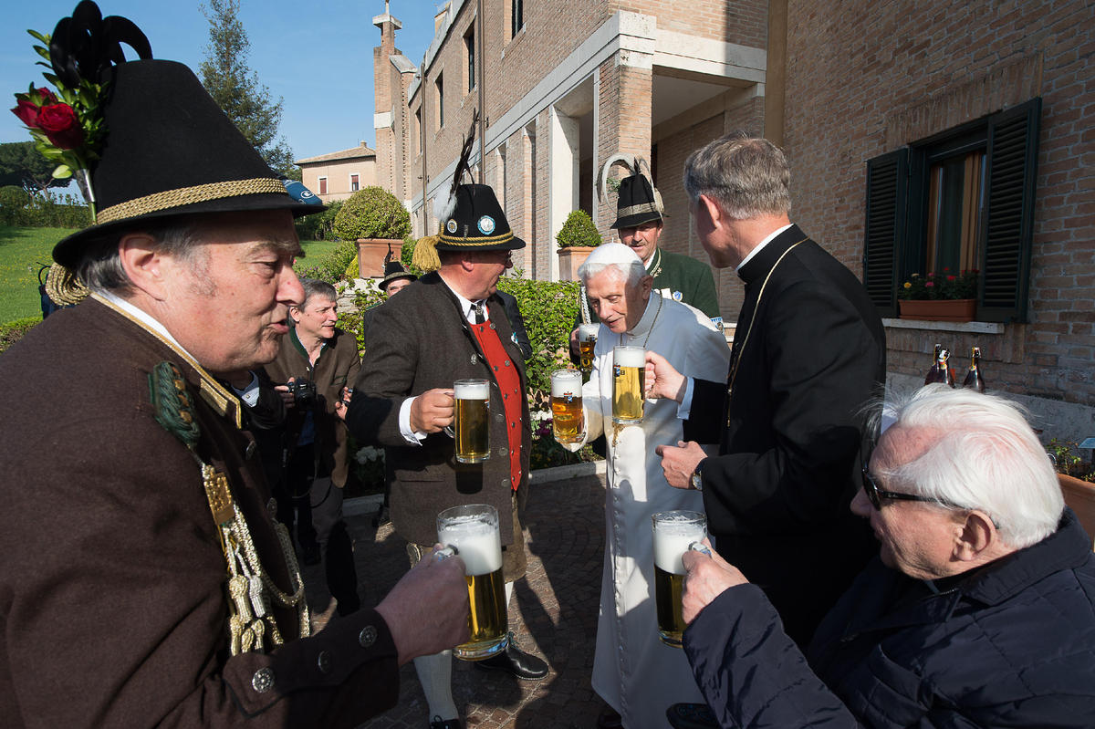 Pope Emeritus Benedict XVI, third from right, toasts for his birthday with his brother Georg Ratzinger, right, Monsignor Geor