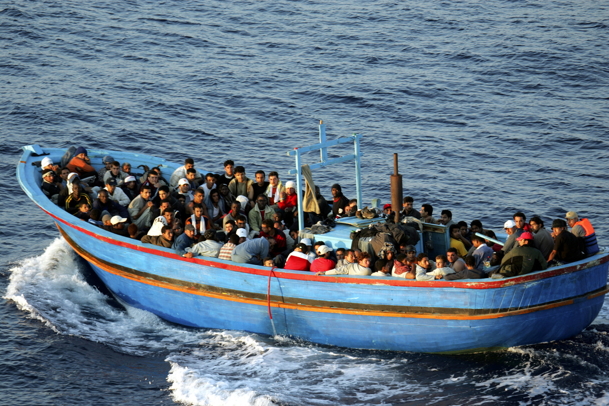 A boat carrying migrants arrives in Lampedusa, Italy, on June 21, 2005.