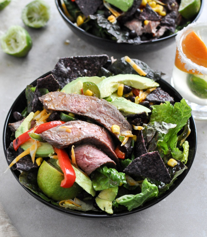 """<strong>Get the <a href=""""http://www.howsweeteats.com/2013/02/tequila-lime-flank-steak-fajita-salad-with-chile-lime-vinaigrett"""