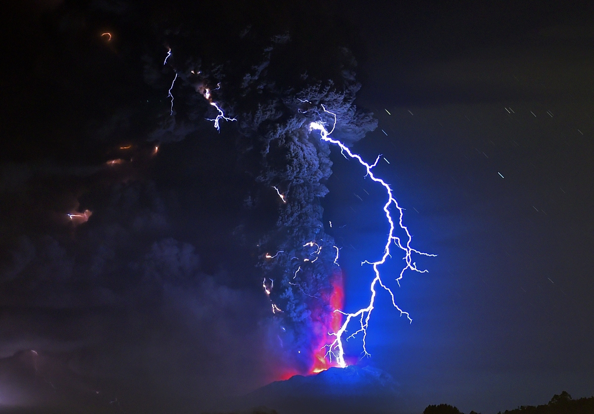 View from Frutillar, southern Chile, showing volcanic lightnings and lava spewed from the Calbuco volcano on April 23, 2015.