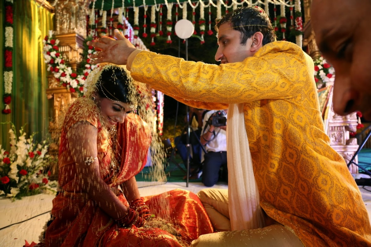 """""""The bride and the groom dunk each other's heads in a gluey mixture of jaggery, ghee and cumin seeds (Myhairmyhairmyhair). E"""