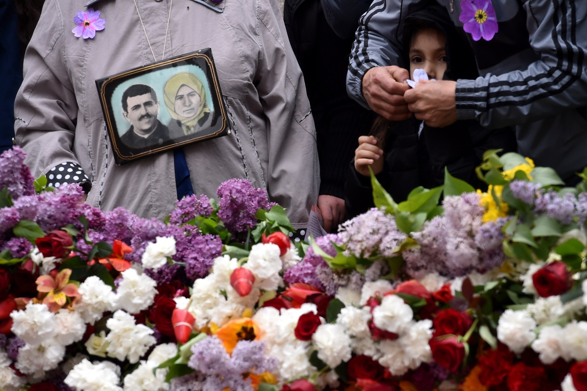 People attend a flower-laying ceremony at the Tsitsernakaberd Memorial, in Yerevan, Armenia on April 24, 2015.