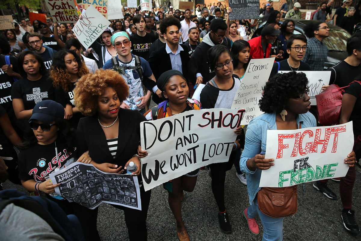 "Students from Baltimore colleges and high schools march in protest chanting ""Justice for Freddie Gray"" on their way to City H"