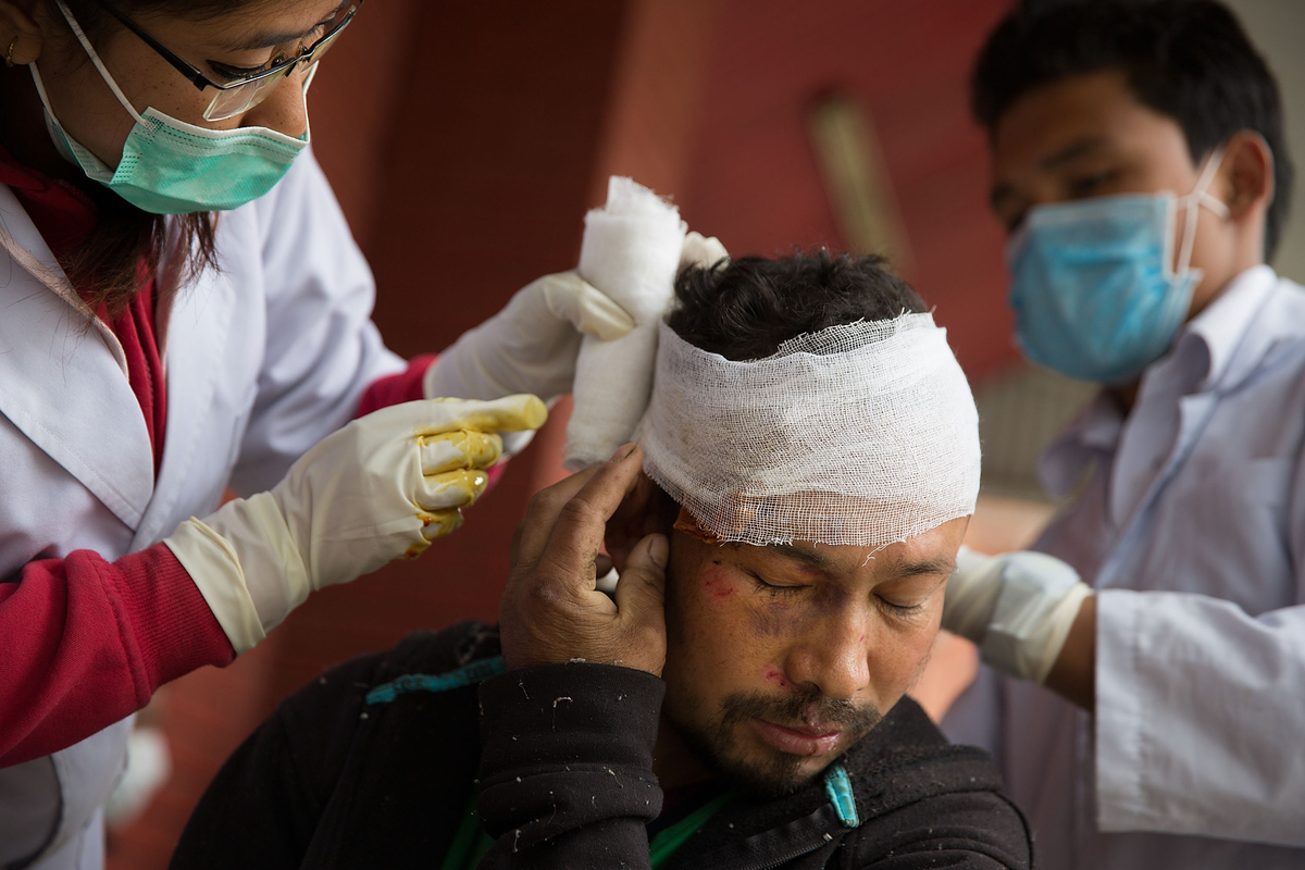 Doctors treat a man injured from falling bricks in Bhaktapur, Nepal on April 30, 2015.