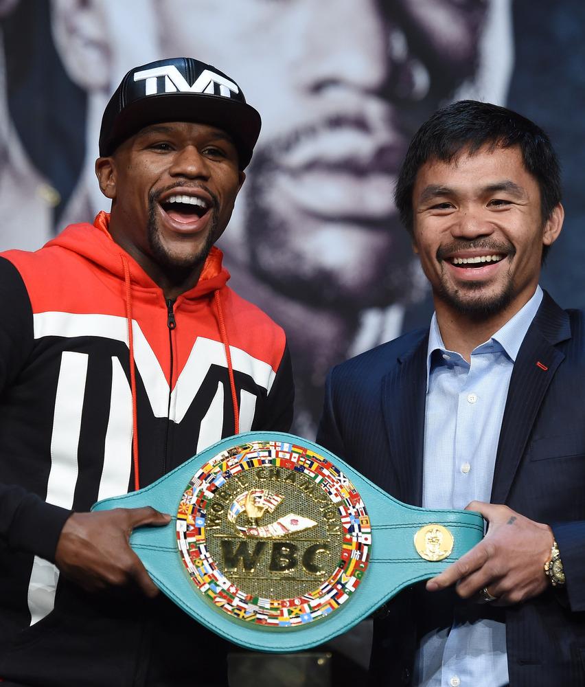 LAS VEGAS, NV - APRIL 29:  WBC/WBA welterweight champion Floyd Mayweather Jr. (L) and WBO welterweight champion Manny Pacquia