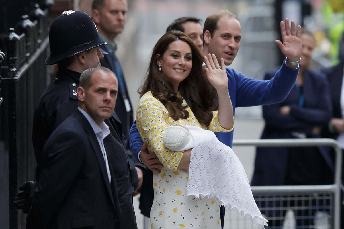 Britain's Prince William and Kate, Duchess of Cambridge and their newborn baby daughter, wave to the public as they leave St.