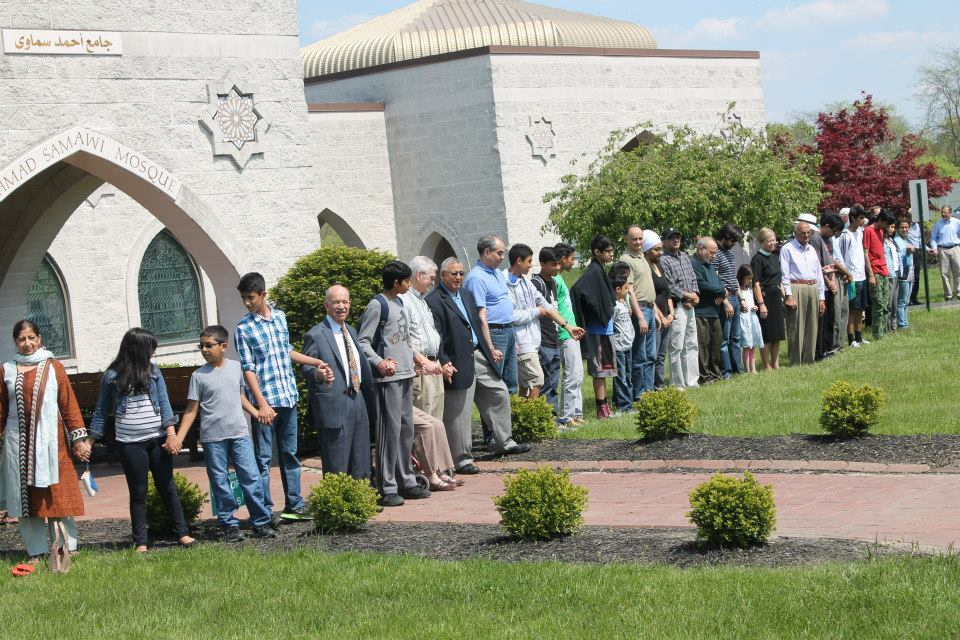 "Community members gather at the Islamic Center of Greater Cincinnati to form a ""peace ring."""