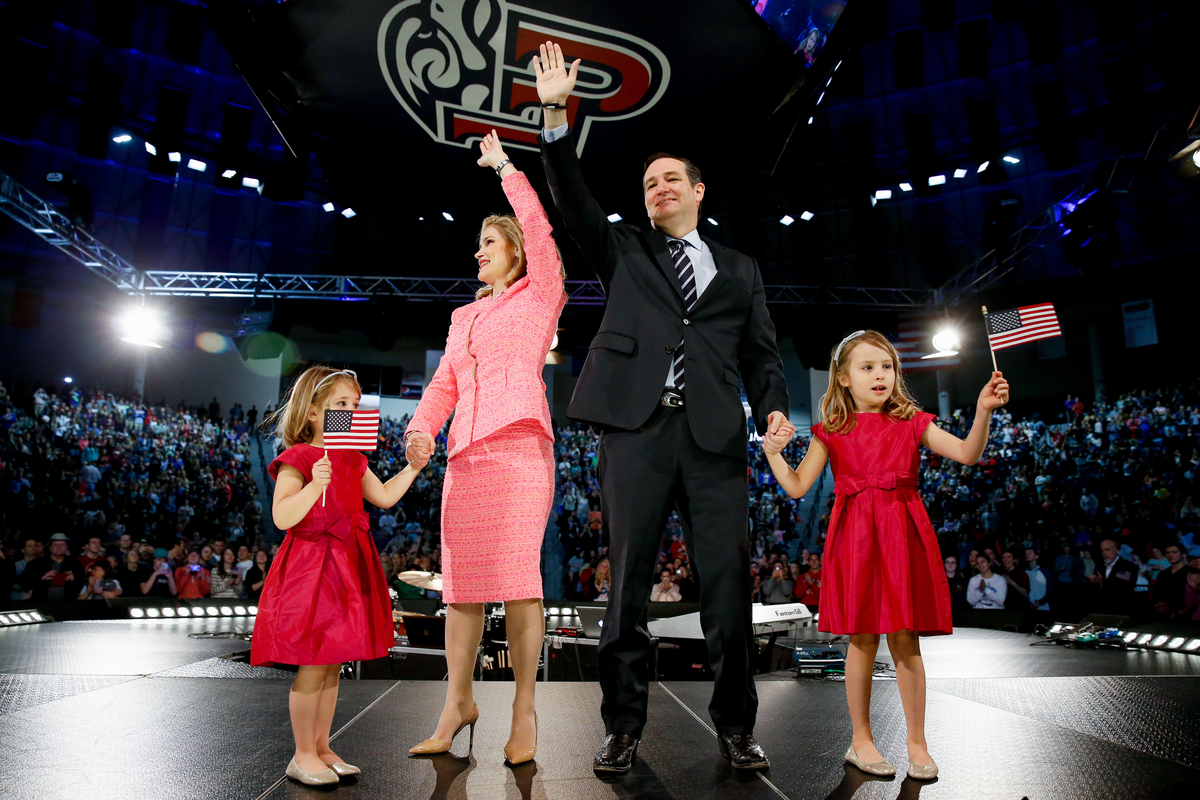 Sen. Ted Cruz (R-Texas), his wife Heidi and their two daughters wave on stage after he announced his campaign for president,