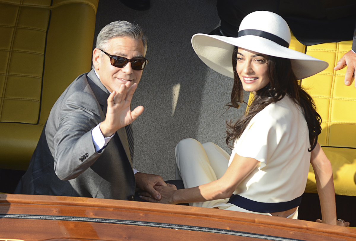 George Clooney and Amal Alamuddin leave the city hall after their civil marriage ceremony in Venice, Italy, Monday, Sept. 29,