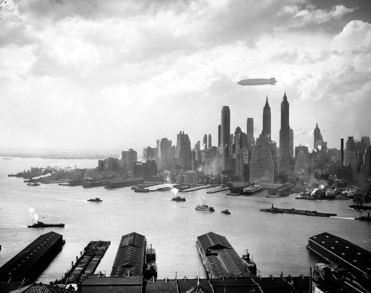 The German zeppelin Hindenburg floats over Manhattan Island in New York City on May 6, 1937.