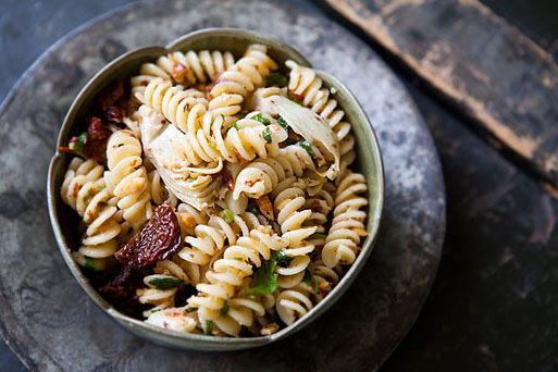 "<strong>Get the <a href=""http://www.simplyrecipes.com/recipes/pasta_with_artichoke_hearts_sun_dried_tomatoes_and_toasted_almo"