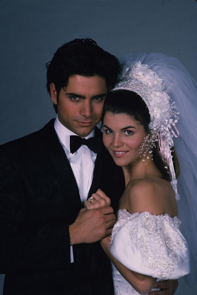 <em>Uncle Jesse (John Stamos) marries Aunt Becky (Lori Loughlin) in a 1991 episode.  </em>