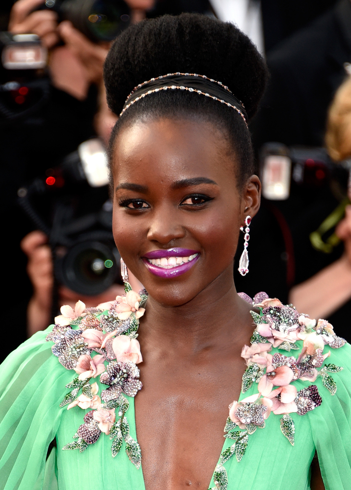 To accentuate Nyong'o's gorgeous green dress, her hairstylist pulled her natural locks up into a headband-adorned bun and her