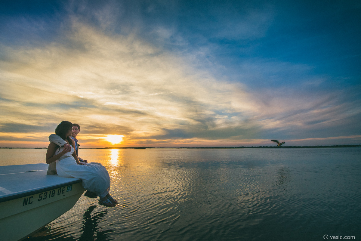 """""""Andrea and Stephen watching an awesome sunset after their wedding dinner on the inner coastal side of Emerald Isle, North Ca"""