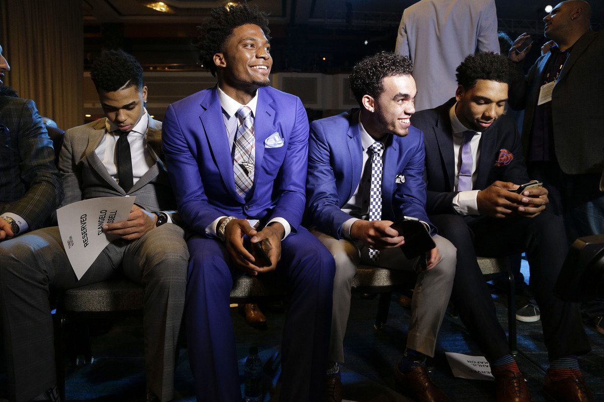 NBA basketball draft prospects, from left, D'Angelo Russell, Justice Winslow, Tyus Jones and Jahlil Okafor wait for the start