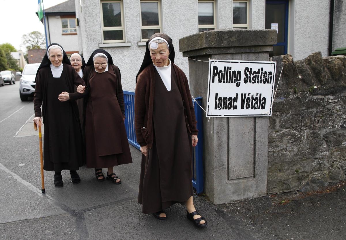 Carmelite sisters leave a polling station in Malahide, County Dublin, Ireland, Friday, May 22, 2015. Ireland began voting Fri