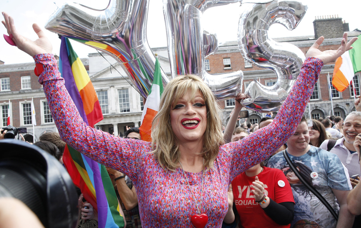Rory O'Neill, known by the Drag persona Panti, celebrates with yes supporters at Dublin Castle, Ireland, Saturday, May 23, 20