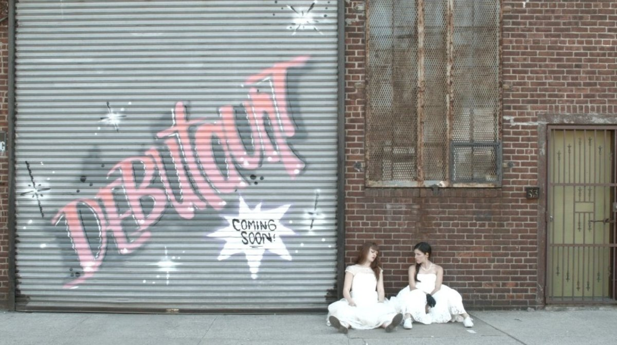 """Cara Seymour & Rachel Guest take a break in front of Atelier Roquette after their """"graffiti"""" shoot for <a href=""""http://debuta"""