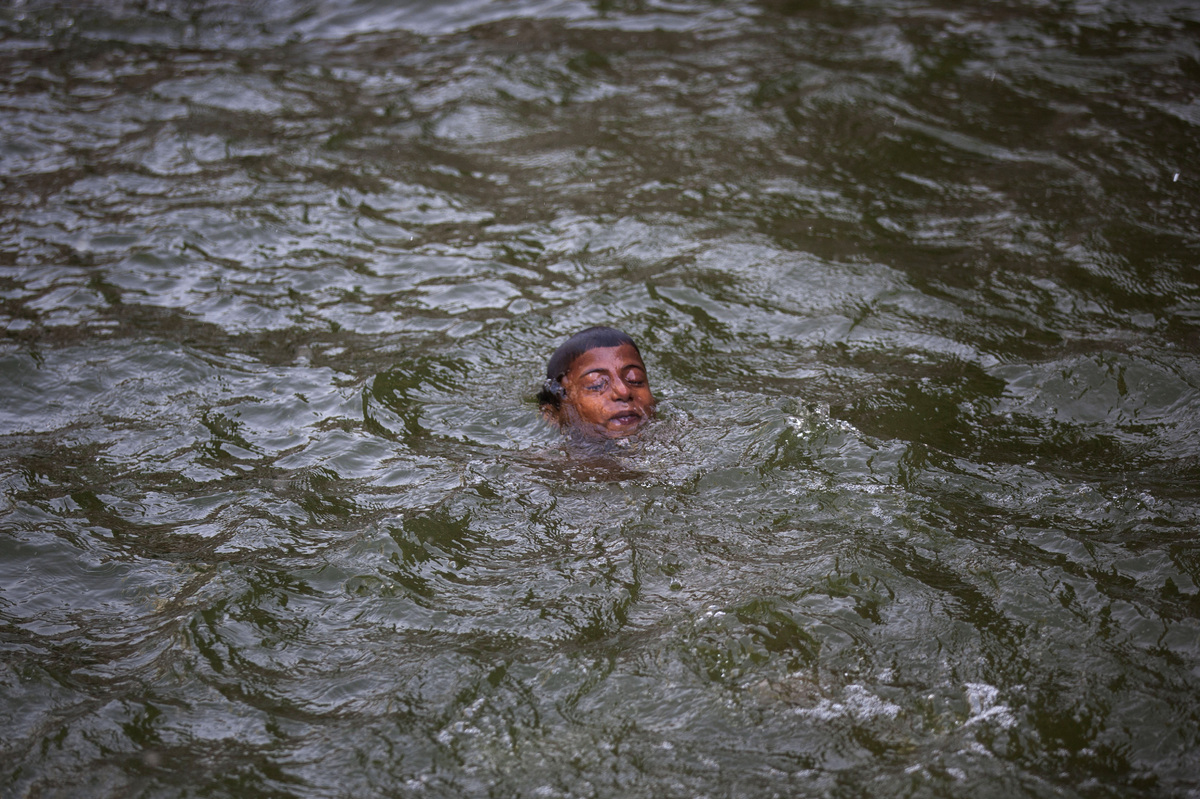 An Indian boy swims in a water body on a hot summer day in New Delhi, India, Tuesday, May 26, 2015. (AP Photo/Tsering Topgyal