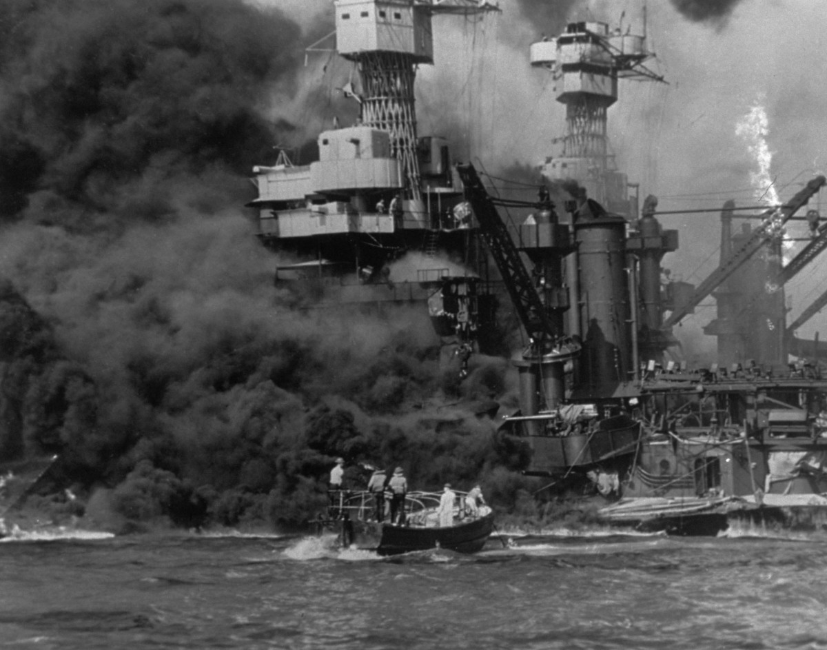 This photo, from December 7, 1941, shows the USS West Virginia in flames after the attack on Pearl Harbor.