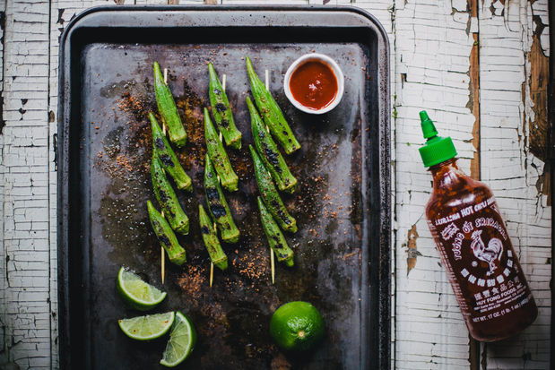 "<strong>Get the <a href=""http://food52.com/recipes/22851-grilled-okra-with-sriracha-lime-salt"" target=""_blank"">Grilled Okra w"