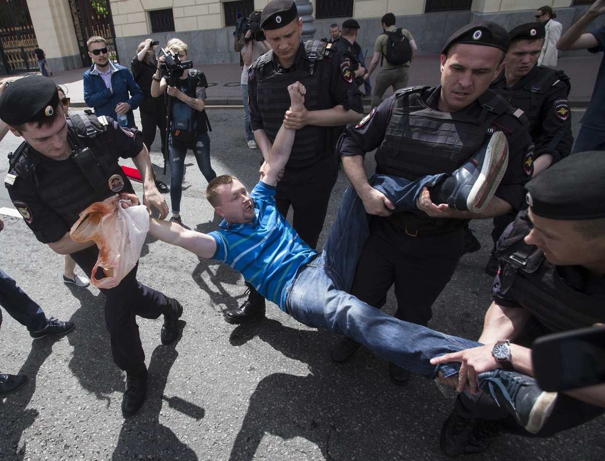 Russian police officers detain gay rights activist Nikolai Alexeyev during an attempt to hold a gay demonstration in Moscow,