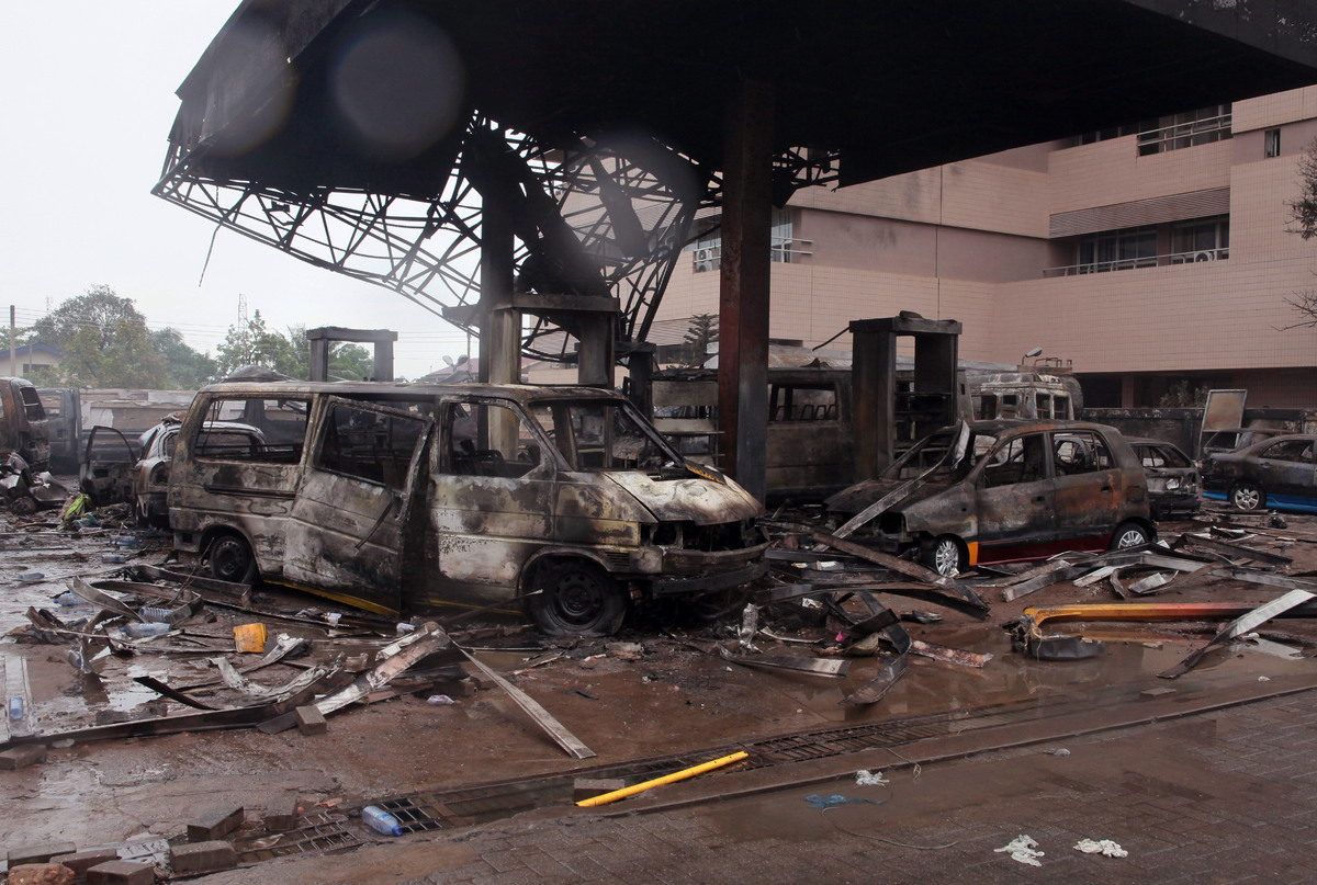 The remaining structure of a gas station after it exploded in Accra, Ghana, Thursday, June 4, 2015. (AP Photo/Christian Thomp