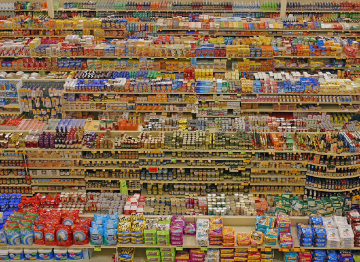 """Grocery stores are strategically designed to place essential ingredients, such as dairy and produce, on <a href=""""http://www.c"""