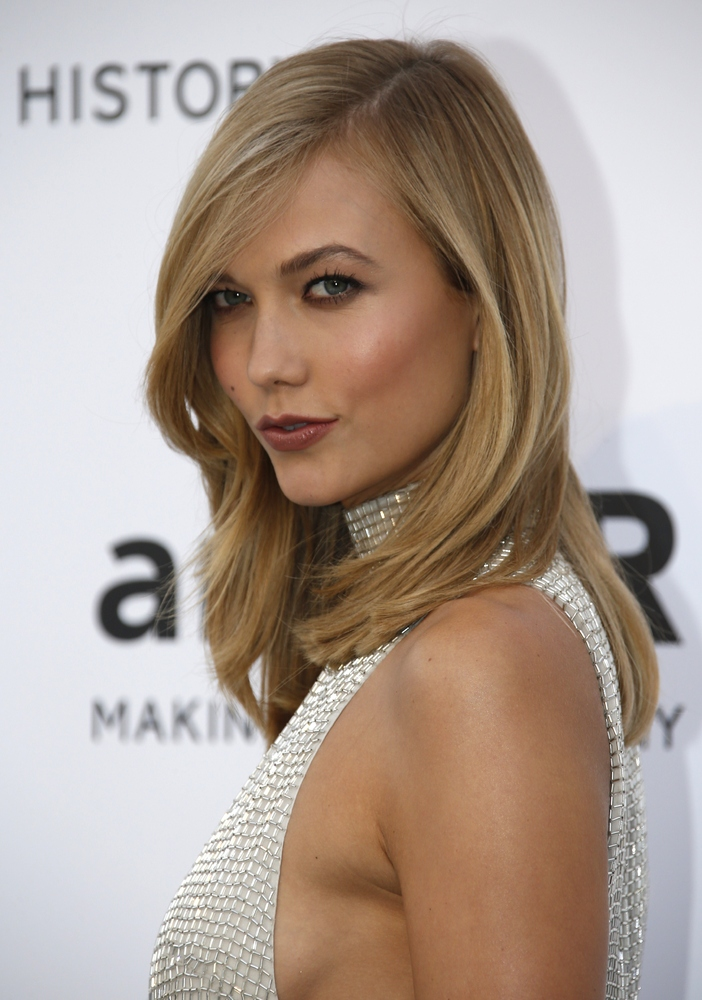 """Karlie Kloss <em>For silky strands like Kloss', prep with <a href=""""http://www.fekkai.com/blowout-collection/heat-protection-s"""