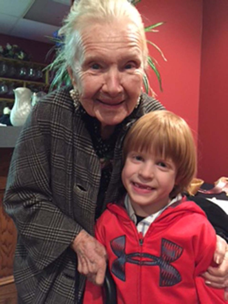 Josephine Jameson at her 100th birthday party with her great-grandson Ian Leshinski.