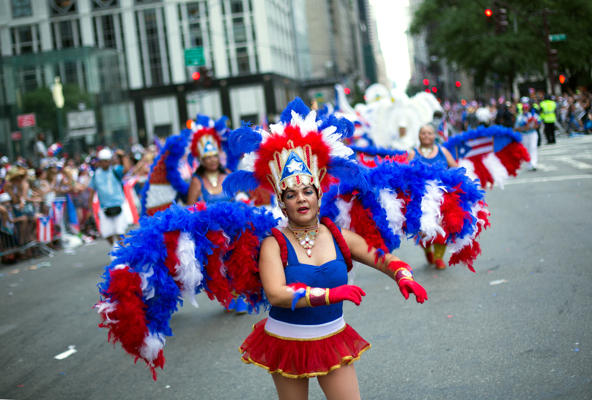 Dancers perform in the annual National Puerto Rican Day Parade as it makes its way up New York's Fifth Ave., Sunday, June 14,