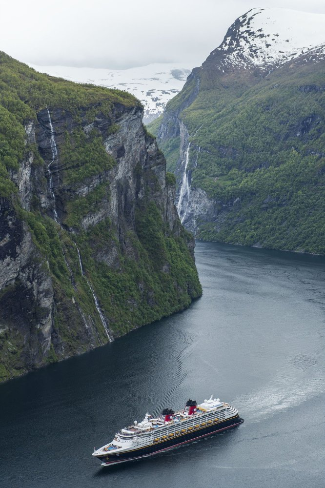 The Disney Magic arrives in Geiranger, Norway, for the first time, sailing through the UNESCO World Heritage Site of Geirange
