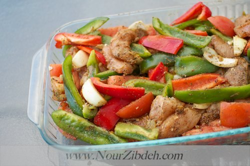 Throw some chicken tenders, peppers and onions in a baking dish. Toss with seasoning and bake for 30 minutes. Serve with slic