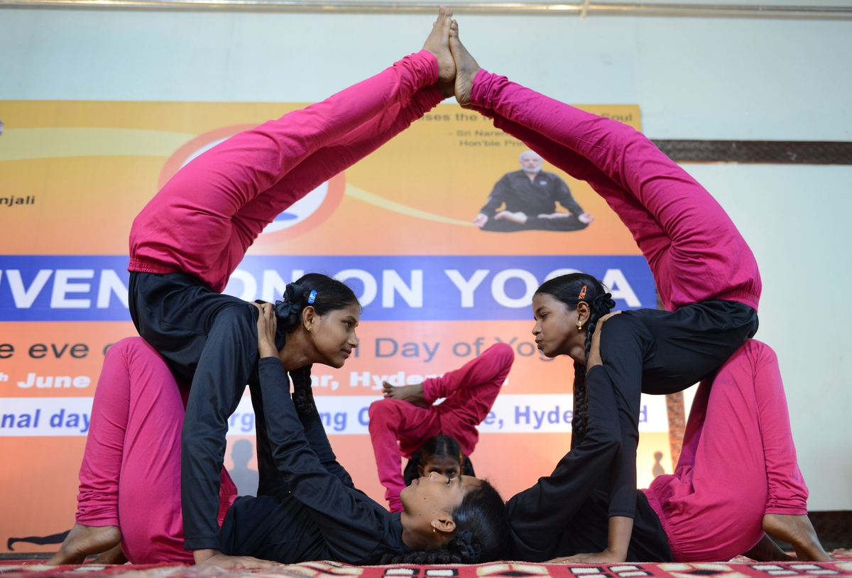 Young Indian girls participate in a yoga convention programme in Hyderabad on June 18, 2015.  The first International Yoga Da