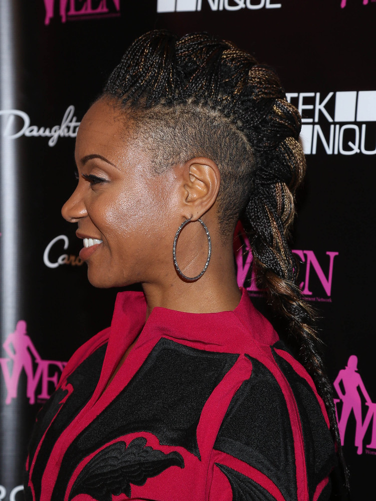 MC Lyte <em>Create a more interesting look by combining individual braids into one large French braid down the center of your