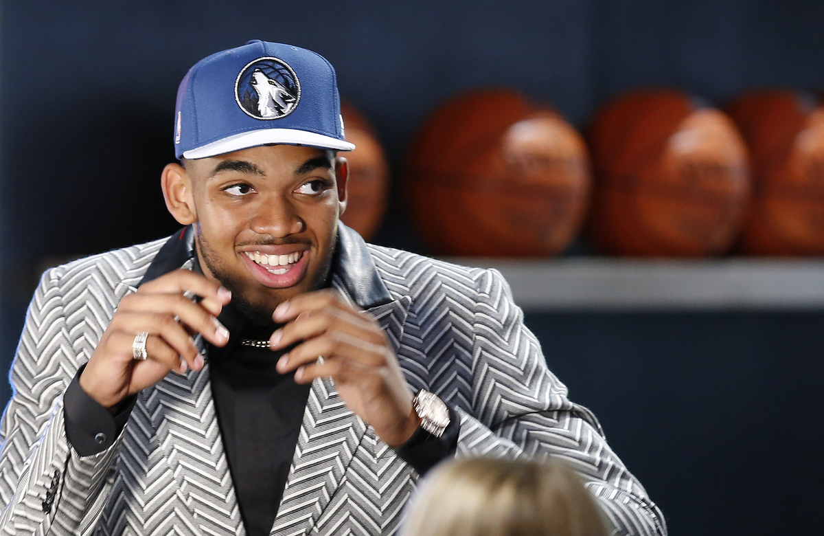Karl-Anthony Towns reacts after being selected first overall by the Minnesota Timberwolves during the NBA basketball draft, T