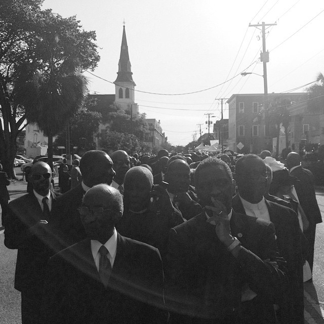 Clergy walk from Emanuel AME Church to TD Arena for Sen. Pinckney's funeral on Friday, June 26, 2015.