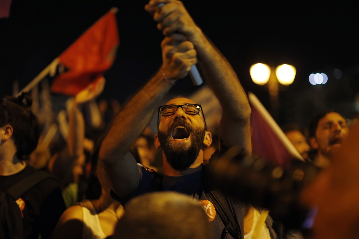 A supporter of the No vote reacts after the results of the referendum at Syntagma square in Athens, Sunday, July 5, 2015. Gre