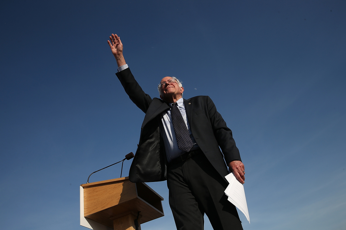 Democratic presidential candidate Sen. Bernie Sanders waves to supporters after officially announcing his candidacy for the U