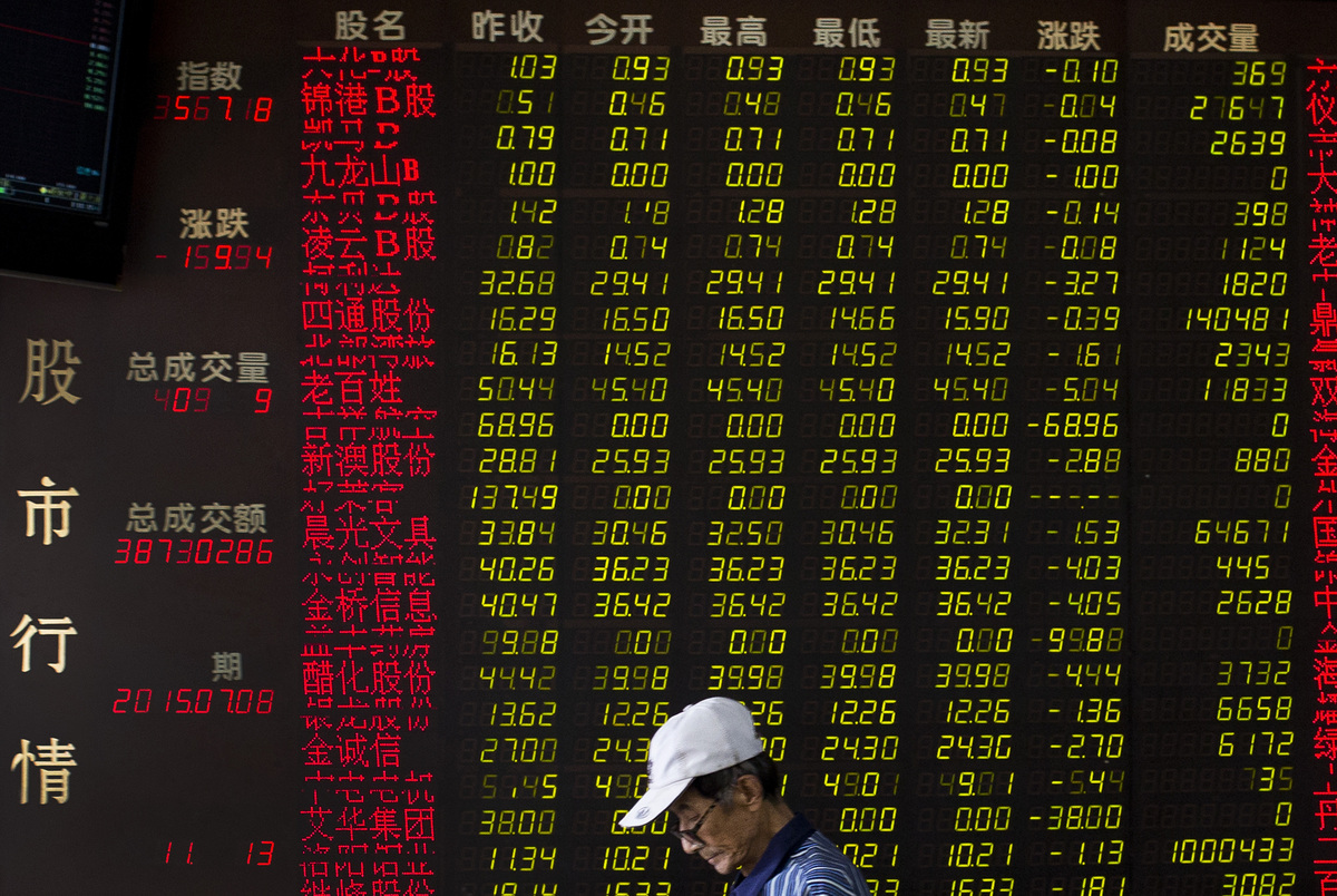 A man walks past an electric board displaying stock prices at a brokerage house in Beijing, China, Wednesday, July 8, 2015. C