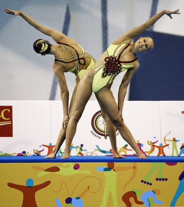Mariya Koroleva and Alison Williams of the United States perform during the synchronized swimming duet technical routine competition at the Pan Am Games Thursday, July 9, 2015, in Toronto. (AP Photo/Mark Humphrey)