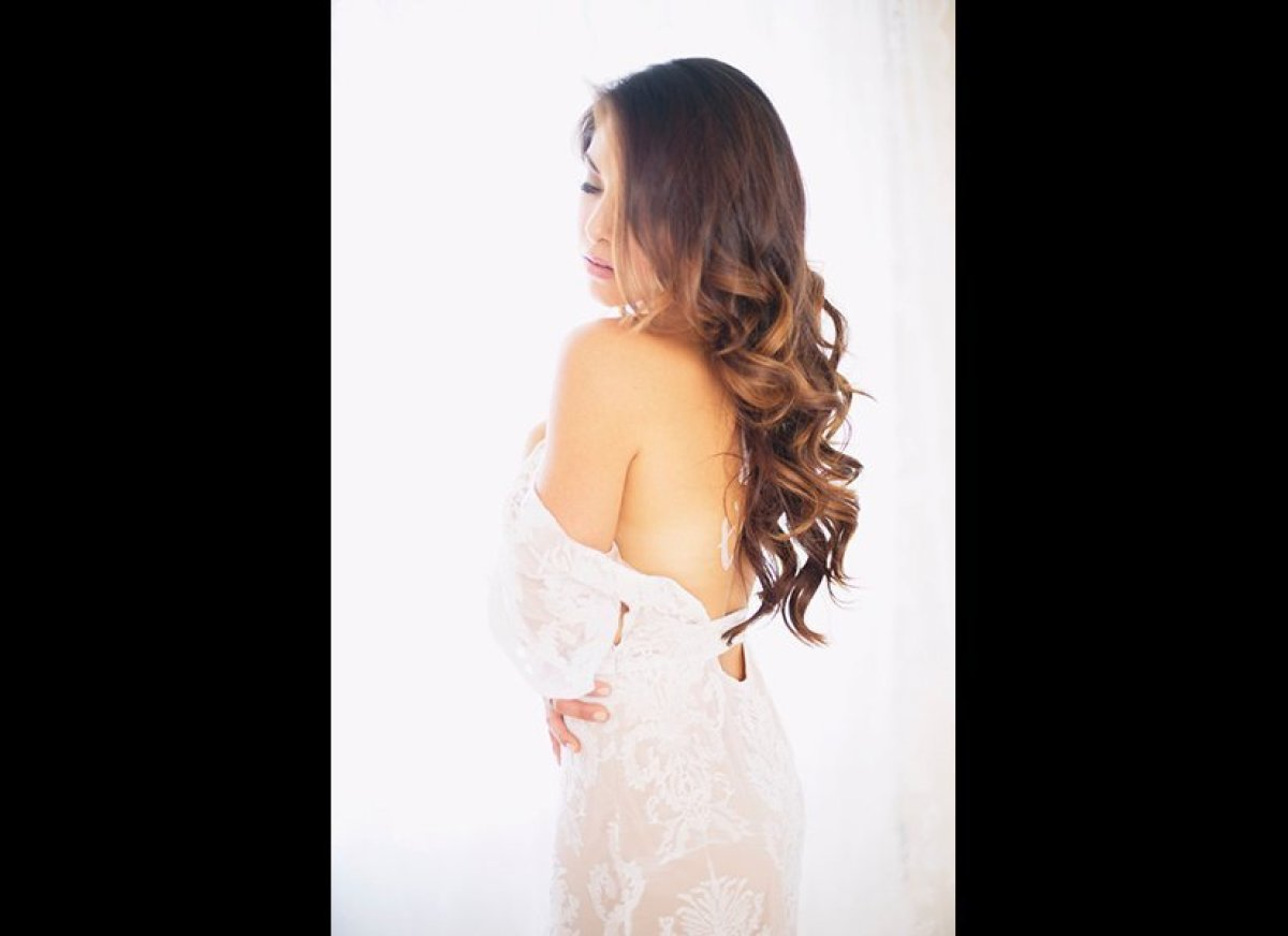 Cascading loose curls epitomize Old Hollywood glamour. They're perfect for a grand ballroom affair!<br><br><em>Photo Credit: